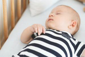Closeup of cute newborn baby sleeping in his cradle