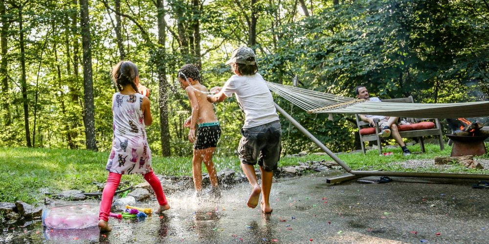Kids playing outside with water balloons