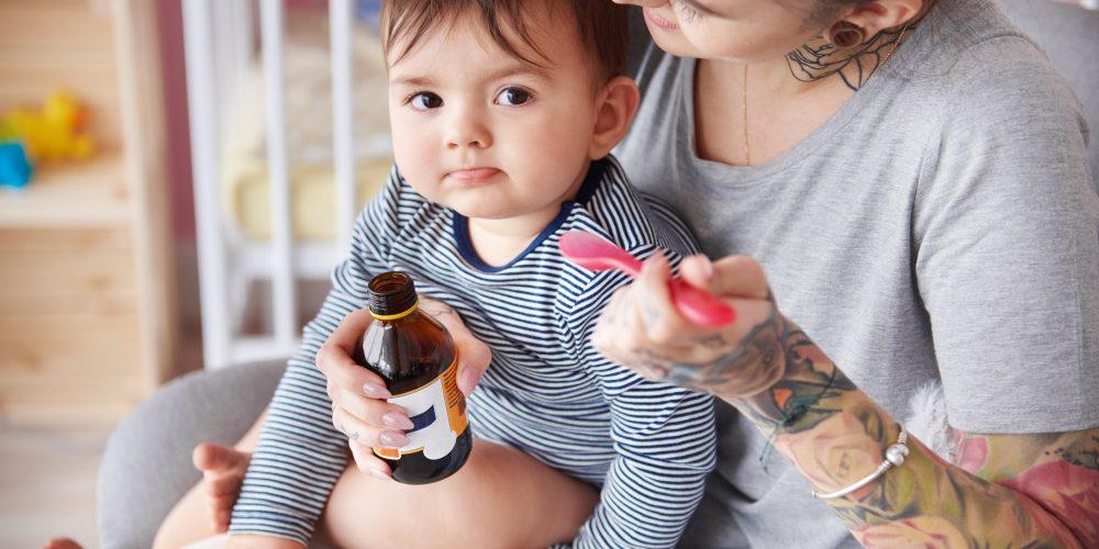Sick baby boy receiving medicines